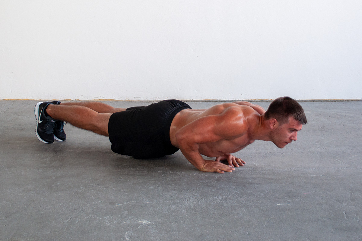 Man lowered into push up position with hands in diamond formation