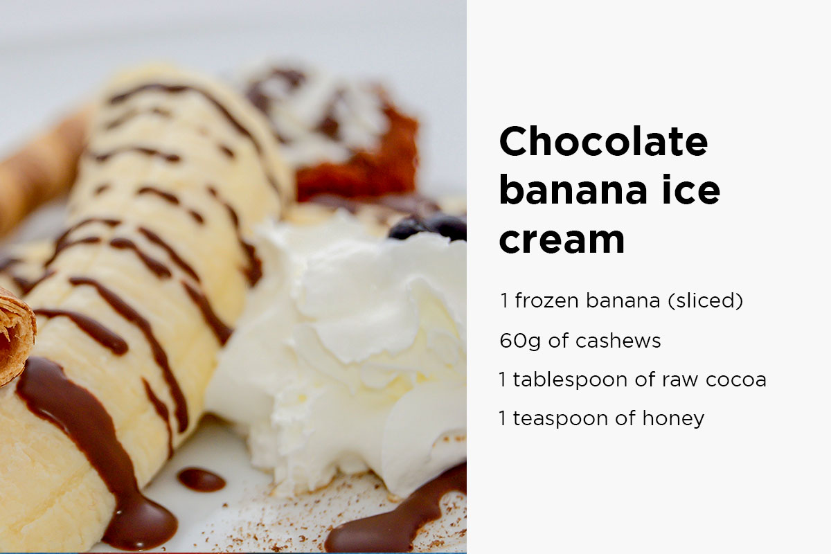 Peeled banana, topped with chocholate topping and cream. Following text written on the right side of the picture: ''Chocolate banana ice cream: 1 frozen banana (sliced), 60g odf cashews, 1 tablespoon of raw cocoa, 1 teaspoon of honey''.