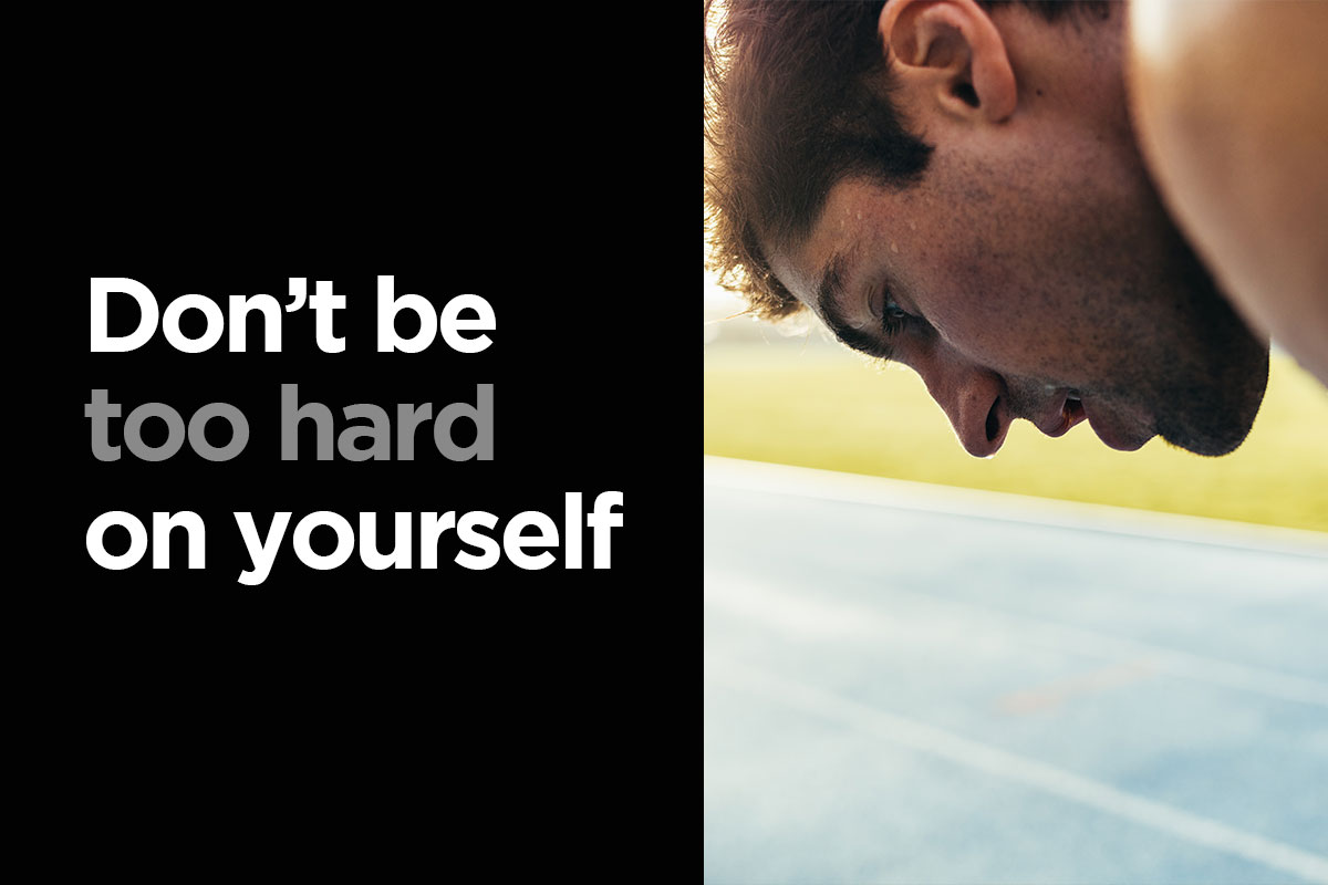 Picture divided on half. On the left half, there is a writting: Don't be too hard on yourself'', white letters on a black background. ON the left, there is a face of a man, he is sweaty and obviously bent over after running or difficult exercise.