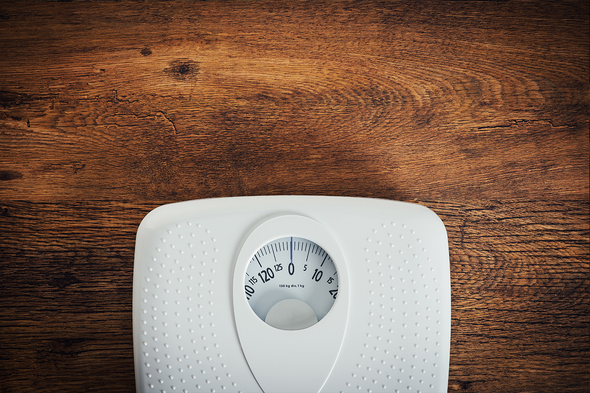 weight scale on a wooden floor, showing zero