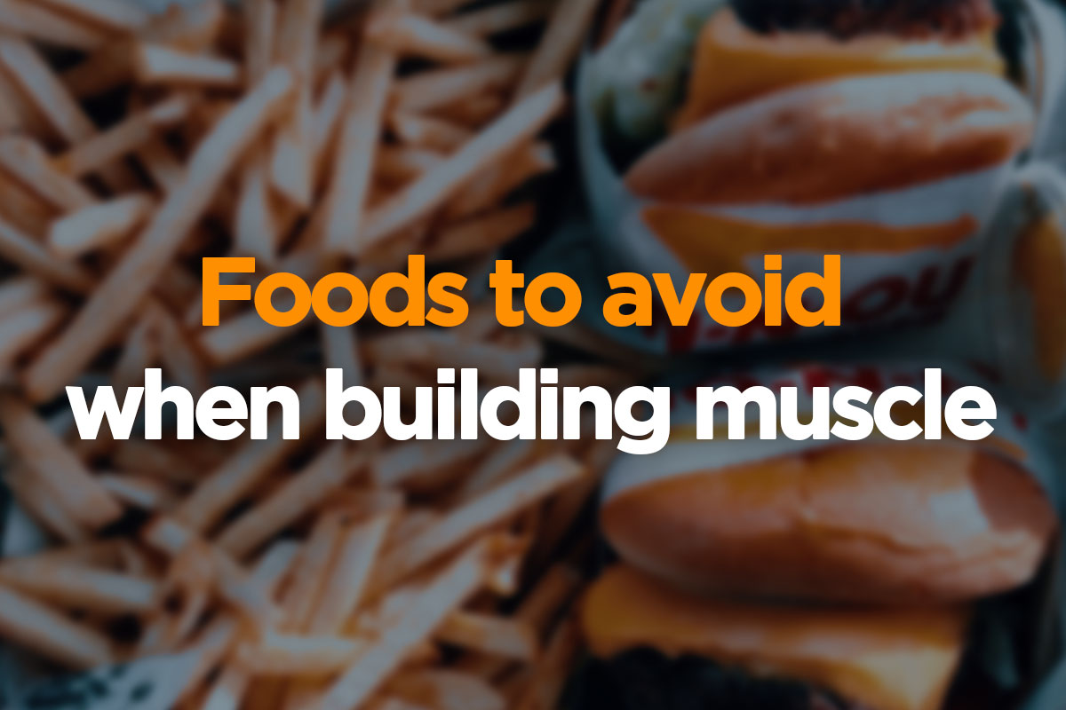 The text is written over the picture in two lines. First, upper line, says ''Foods to avoid'' and is written in orange font. Second, lower line, is written in a white font and is saying: ''when building muscle''. The writing is placed on a blurred picture of french fries and two burgers.