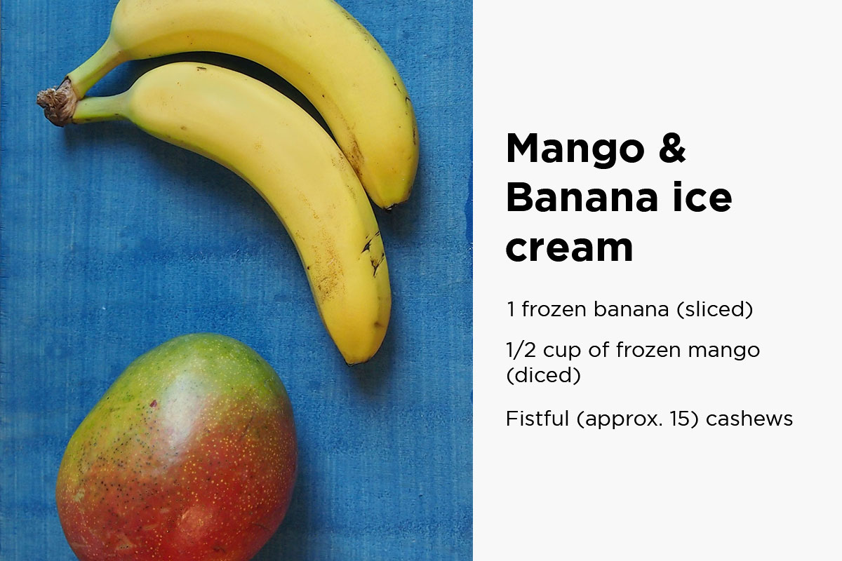 Mango and two bananas on a blue background with the following text written on the right side of the picture: ''Mango and banana ice cream: 1 frozen banana (sliced), 1/2 cup of frozen mango (diced), fistful (approximately 15) cashews''.